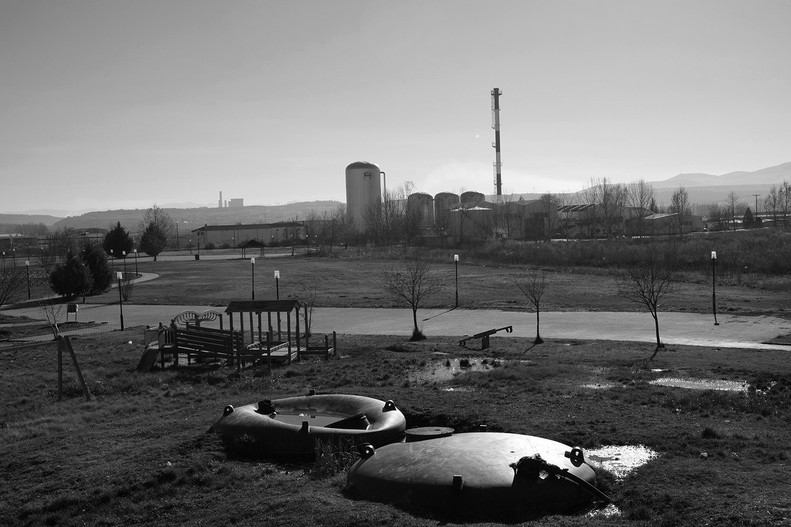 The dystopian park juxtaposed to the factory.