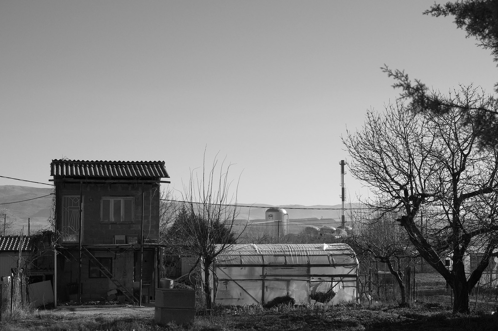 The factory. Landscape at the outskirts of my town.  The cold winter in my heart. Pollution in the air. This smell comes directly form my memories as a child. © DIMITRIOS GIOVIS