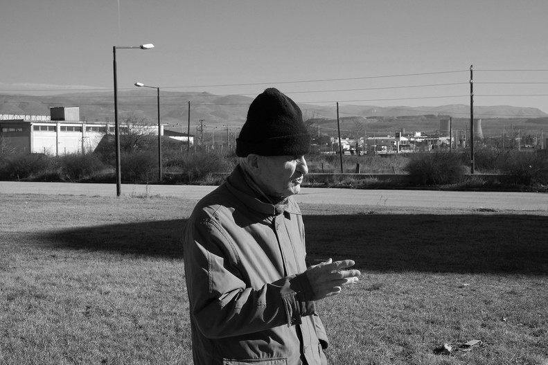 Paternal gestures. Facial expression, hands, fingers… such a familiar language, a body talk. Under the cold wintery sunlight, in front of the industrial scene of my hometown. Where am i? © DIMITRIOS GIOVIS
