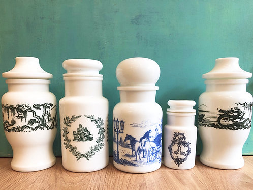 Five retro milk glass canisters