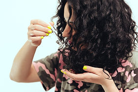 Woman applying natural oil on the tips o