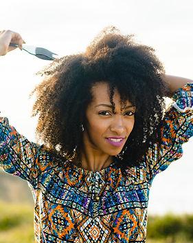 Beautiful young woman using afro hair co