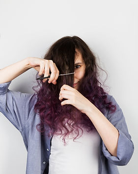 Young girl cuts to herself curly purple