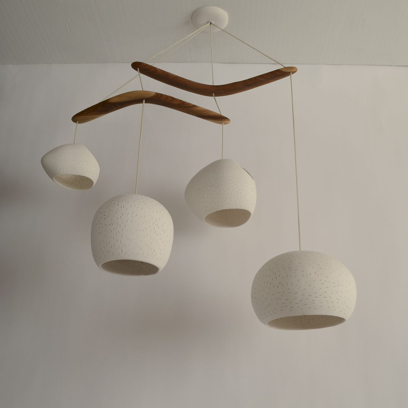 Lightexture unique designer lighting claylight boomerang extra four large ceramic light shades hang from two australian brigalow wood boomerangs and create a mobile of lights textures and shapes in this juan miro arubaitofo Choice Image