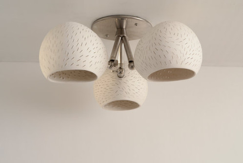 Claylight clover designer flush mount ceramic ceiling lighting this flush mount ceiling light is made of three perforated white ceramic shades arranged in a clover pattern it shines light patterns on the ceiling around aloadofball Image collections