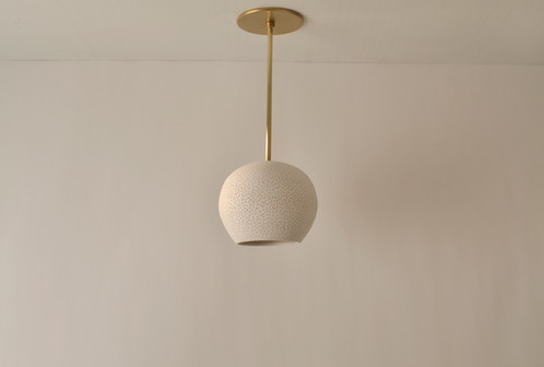 Modern ceiling lighting clay light pendant with brass rod a perforated white ceramic shade hangs from a 12 brass rod and creates an elegant ceiling light fixture aloadofball Choice Image