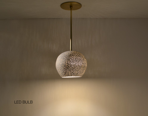 A Perforated White Ceramic Shade Hangs From 12 Brass Rod And Creates An Elegant Ceiling Light Fixture
