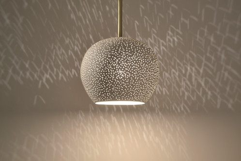 Modern ceiling lighting clay light pendant with brass rod a perforated white ceramic shade hangs from a 12 brass rod and creates an elegant ceiling light fixture aloadofball Image collections
