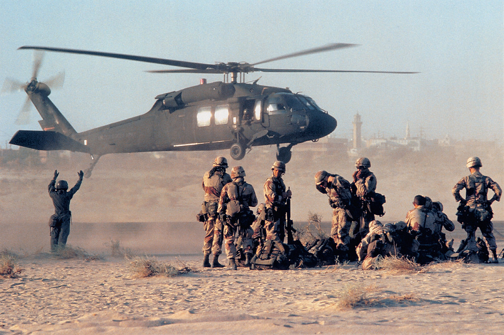 Soldiers and a helicopter in desert