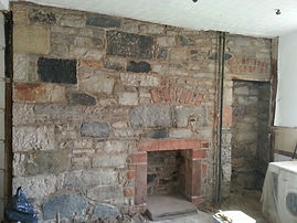 Repointed & restored internal wall with reinstated fireplace