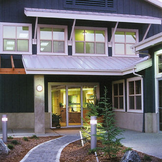 Randel Dental Clinic, a modern wood and steel dental office with large dormers- Pelletier + Schaar