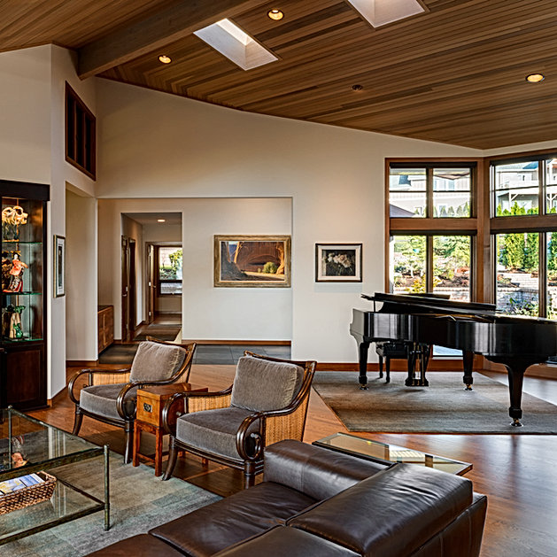 Camano Residence vaulted living room with wood ceilings, skylights and built-ins - Pelletier + Schaar