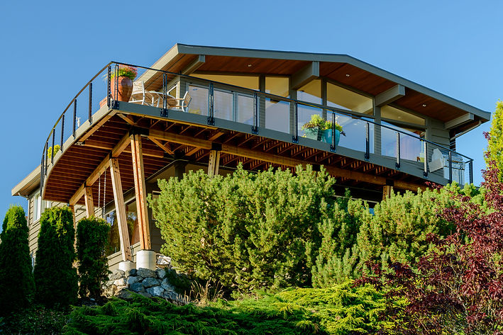 Smith Addition & Deck mid-century modern home with open great room and curved deck - Pelletier + Schaar