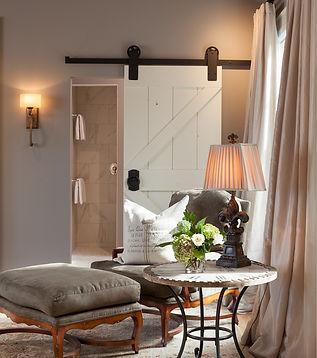 White barn door to master bathroom, quiet spot next to window - Pelletier + Schaar