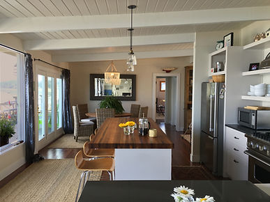 Morelli, open great room with beamed ceiling, white kitchen and natural finishes - Pelletier + Schaar