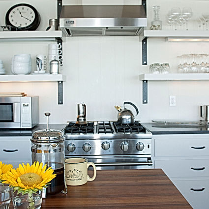 Morelli; white kitchen with open shelves and wood island - Pelletier + Schaar