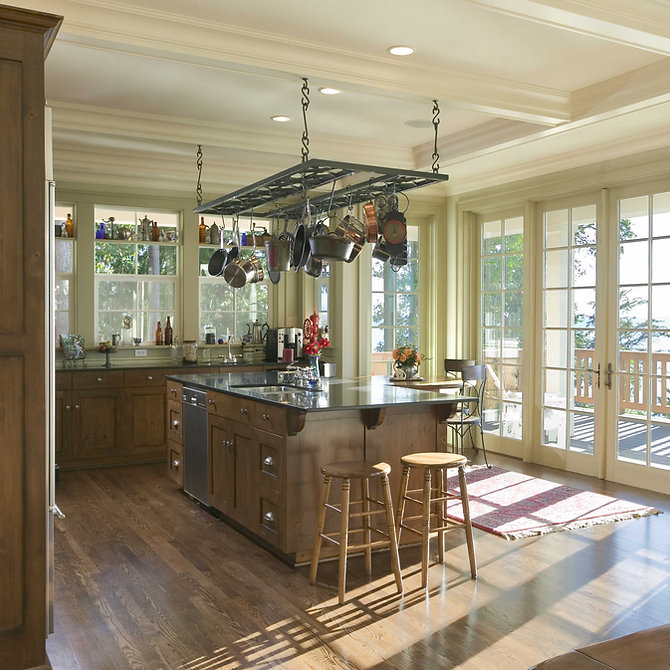 Ruebel house open kitchen surrounded by windows with island and pot rack - Pelletier + Schaar