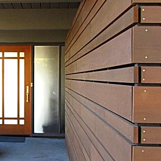 Smith Addition + Deck, new cedar inter-weaved rain screen leading to front door - Pelletier + Schaar