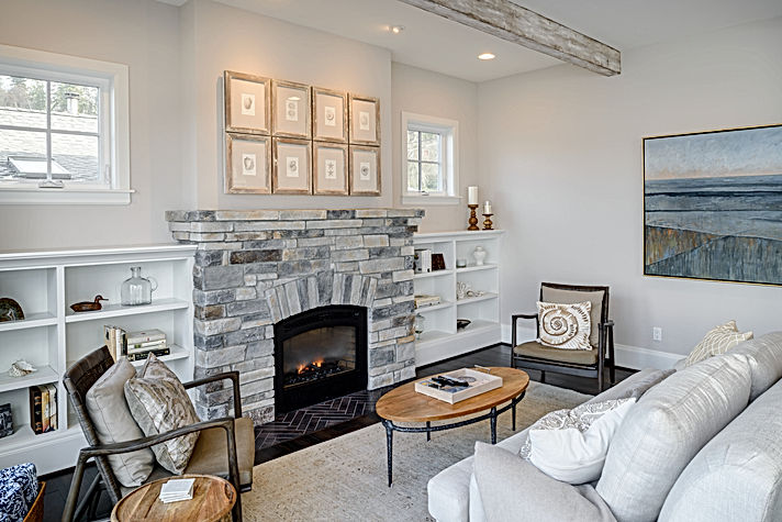 O'Neill Residence living room with built-in shelves flanking a stone fireplace - Pelletier + Schaar