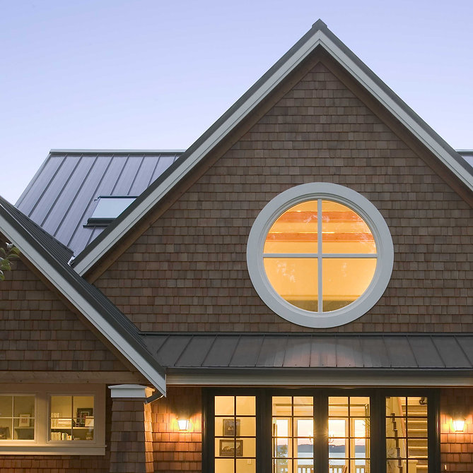 Ruebel House symmetrical porches and large round window lend a unique aire to a shingle style house - Pelletier + Schaar