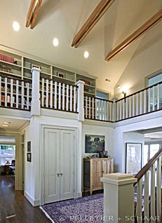 Ruebel House two story entry with library balcony above - Pelletier + Schaar