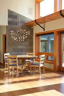 Ferrill Residence dining area with exposed concrete block and a light shelf that bounces light further back into the room - Pelletier + Schaar