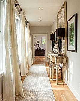 Light filled hall with wood floor and white trim - Pelletier + Schaar