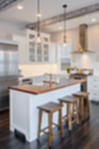 O'Neill Residence white kitchen with wood counter and stools - Pelletier + Schaar