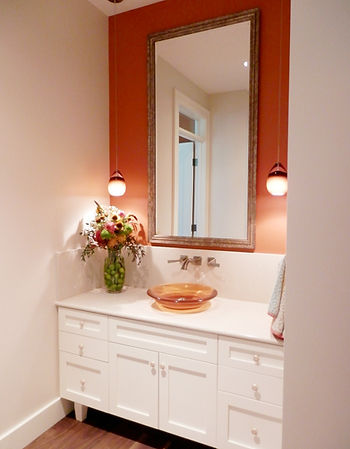 Island Farmhouse red bathroom with white cabinets and glass bowl sink - Pelletier + Schaar