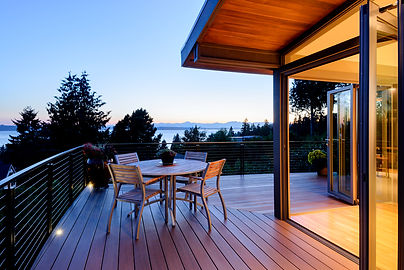 Smith Addition & Deck view of mountains and water at dusk - Pelletier + Schaar