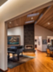 Camano Residence vaulted living room with wood ceilings, skylights and grand piano - Pelletier + Schaar