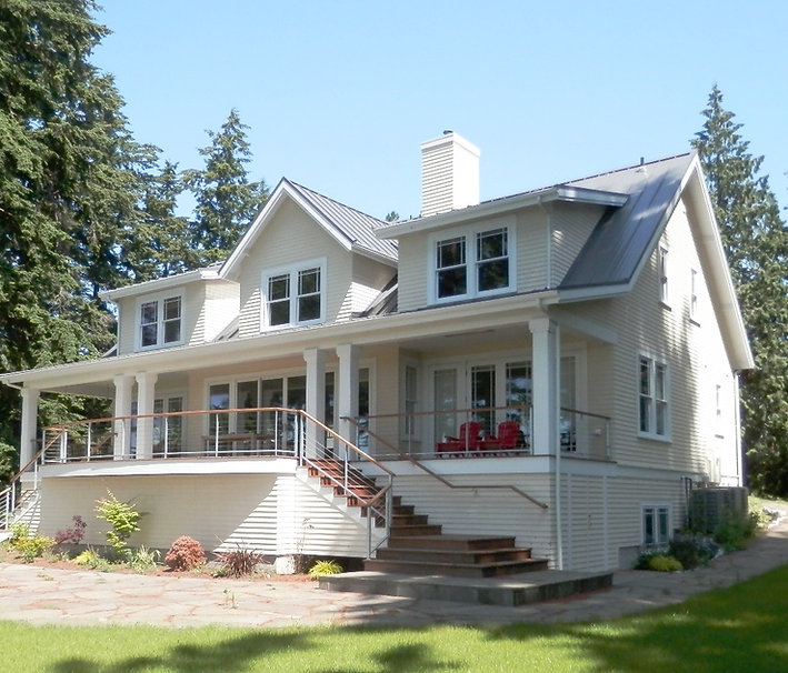 Island Farmhouse wide porch and deck with cable railing - Pelletier + Schaar