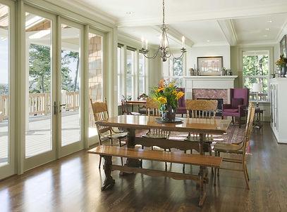 Ruebel Residence traditional style great room opening to deck and views - Pelletier + Schaar