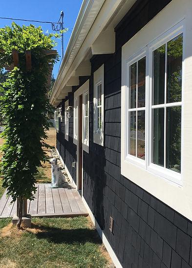 Morelli; black shingled beach cottage with cream trim - Pelletier + Schaar