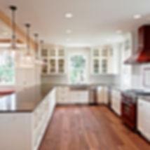 Island Farmhouse white kitchen with red hood - Pelletier + Schaar