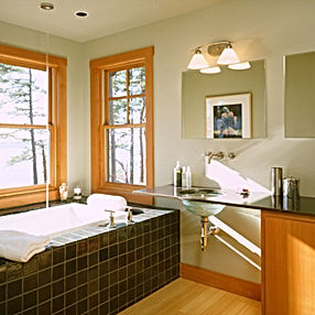 Bomgardner Residence master bathroom with tiled in tub surrounded by windows and a glass sink - Pelletier + Schaar