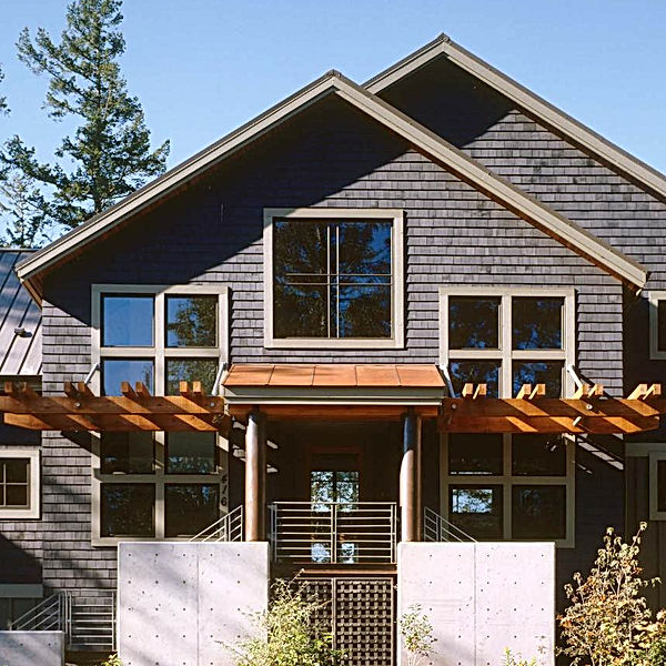 Bomgardner Residence with shingle, a metal roof, and a copper roofed front porch with concrete, steel and a wood trellis - Pelletier + Schaar
