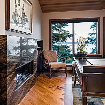 Camano Residence den with wood ceiling and marble fireplace - Pelletier + Schaar