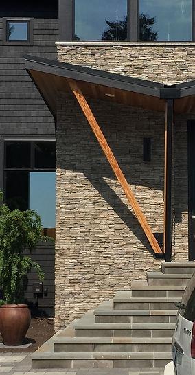 Ferrill Residence galvanized steel spiral stairs connect gardens to the main floor deck - Pelletier + Schaar