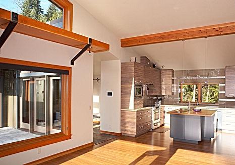 Ferrill Residence kitchen with beamed ceiling and a light shelf - Pelletier + Schaar