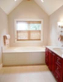 Island Farmhouse dormer bathroom with built-in tub - Pelletier + Schaar