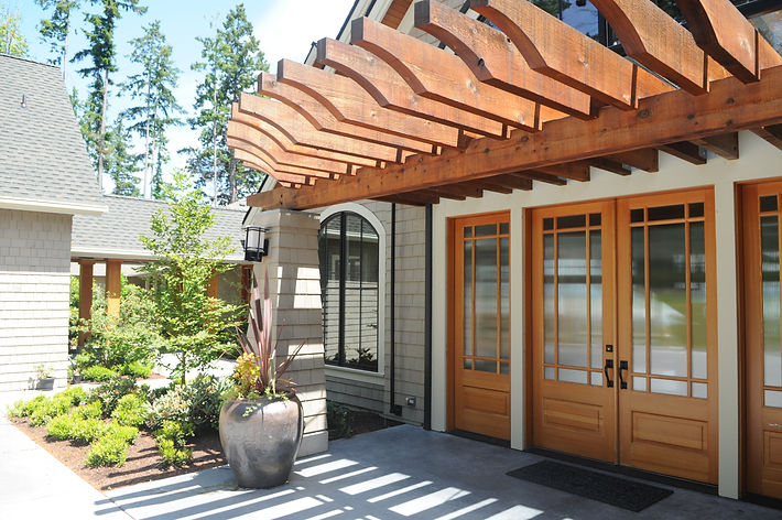 Bomgardner Residence contemporary back deck with shingles, concrete, steel and a wood trellis - Pelletier + Schaar