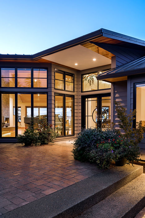 Camano Residence entry courtyard with views through the home to the water - Pelletier + Schaar