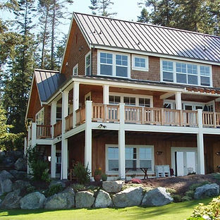 Ruebel House - Shingle, coastal style with metal roof and wrap around porch - Pelletier + Schaar