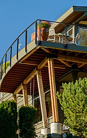 Smith Addition & Deck cantilevered curved deck supported by gluelam beams and braces - Pelletier + Schaar