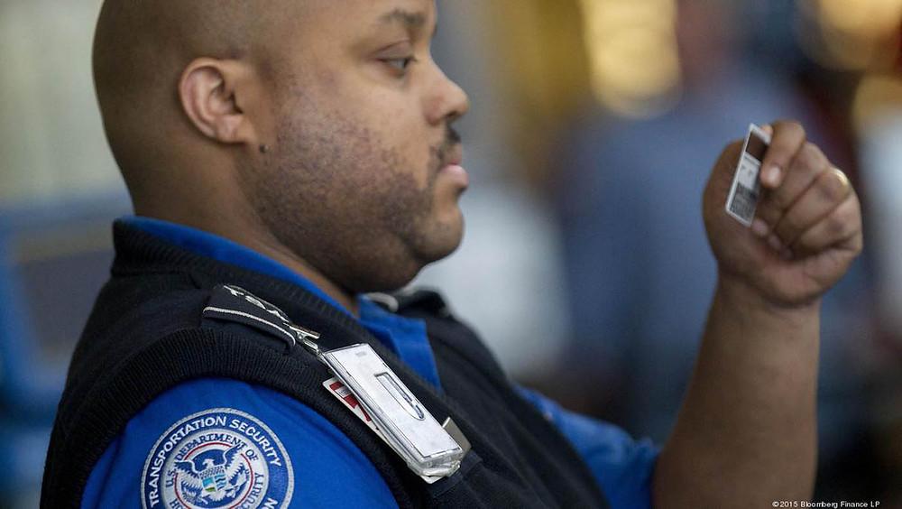 TSA officer checking passenger ID card