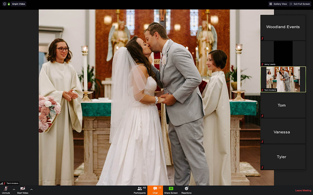 bride and groom kissing on zoom during livestream wedding ceremony