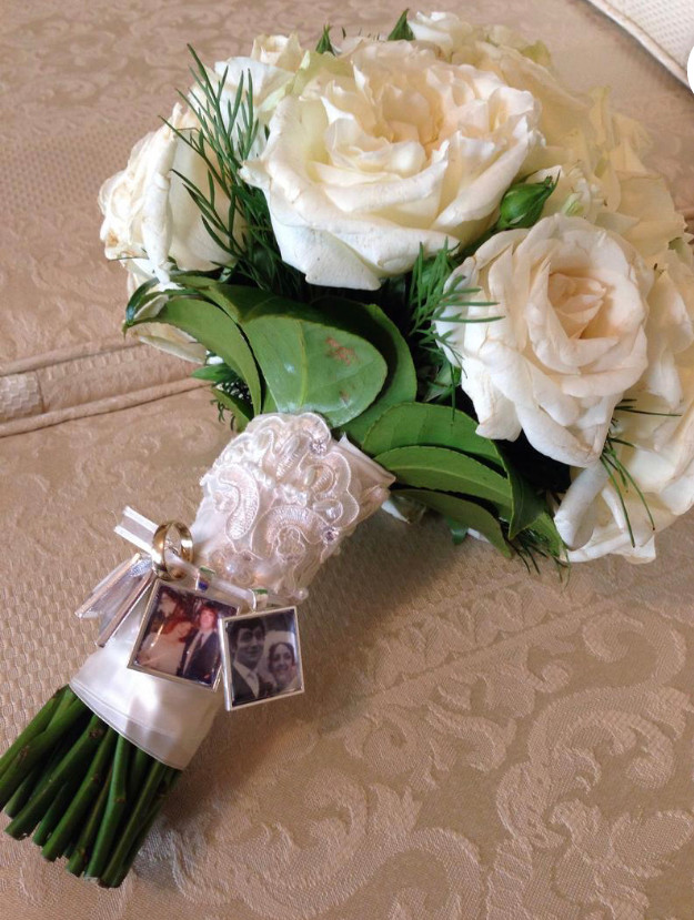 bridal bouquet with charms attached to honor lost loved ones