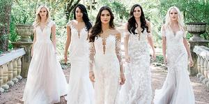 Five bridal models walking on a stone bridge.