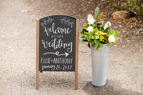 Welcome to our wedding chalkboard sign with flowers at Rancho La Patera and Stow House in Goleta, California